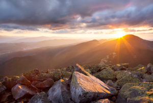 Majestic sunset in the mountains landscape. Dramatic sky and colorful stones. Carpathians, Ukraine, Europe