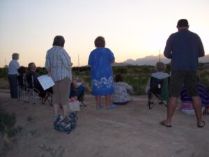 Praying at dawn in the desert