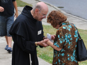 Fr. Paul Faroh prays with a pilgrim at the Basilica and National Shrine of Our Lady of Consolation in Carey, OH. Fr. Paul loves to feed people spiritually as well as by sharing his culinary gifts. Click here for a few of his recipes.
