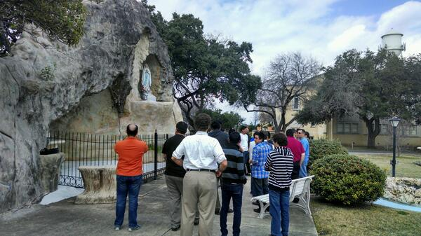 At the grotto of Our Lady of the Lake University