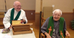 Friars Fr. Jude Rochford and Fr. Juniper Cummings celebrate Mass at the Health Care Center where they reside.