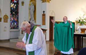 Fr. Maurus and Fr. David Lenz, OFM Conv., give the blessing at the end of Mass.