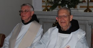 Friars Fr. Ken Gering and Fr. Simon Sauer preparing to concelebrate at Mass Christmas Eve 2013