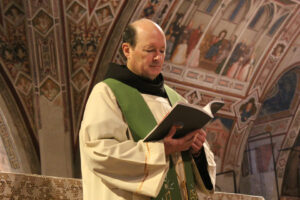 Fr. Jim prays in the Portiuncula (the small chapel of St. Francis) in Assisi, Italy.