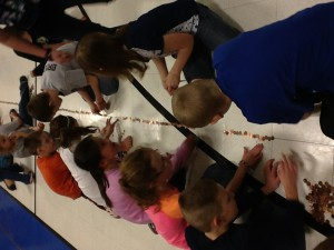 Lining up the pennies at the OLC Penny Challenge...