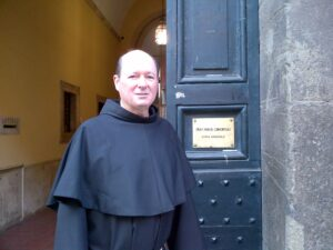 Fr. Jim stands in the doorway of the Conventual Franciscan Residence in Rome.
