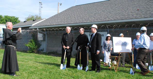 Fr. Charles McCarthy, OFM Conv., takes a photo of Archbishop Kurtz, Fr. Jim Kent, OFM Conv., and Chuck Mattingly