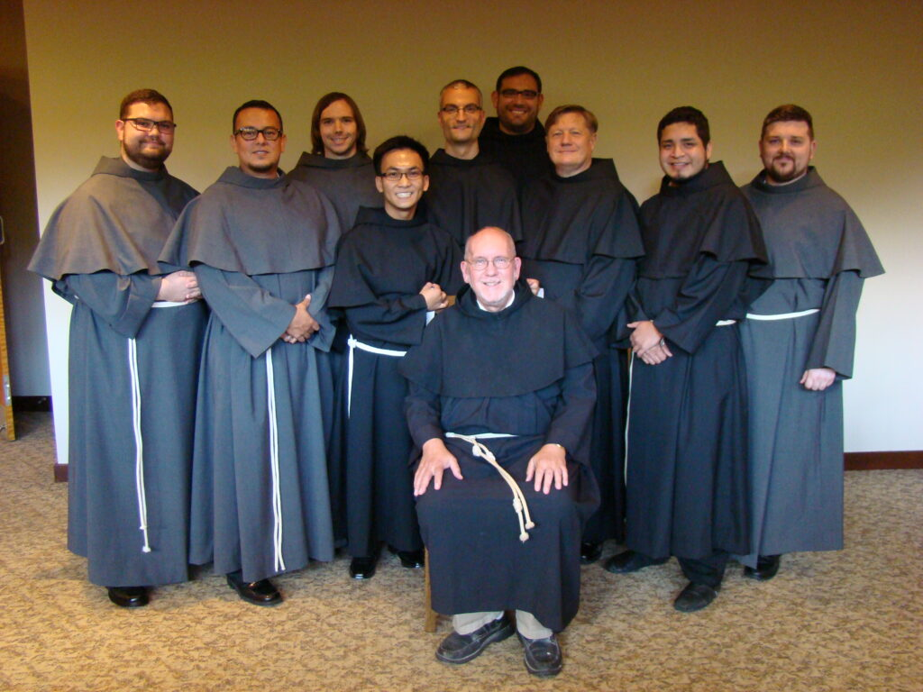 Fr. David Lenz (seated) will be leading a retreat for the new novices.