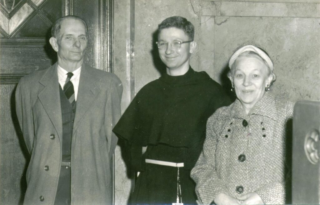 Br. Joe in an early 1950s photo, posing with his parents at the Basilica and National Shrine of Our Lady of Consolation in Carey, OH