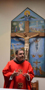 Friar John Stowe, Vicar Provincial, presides at the opening Mass of the Holy Spirit on Monday. The large painting behind the crucifix is called a retablo.