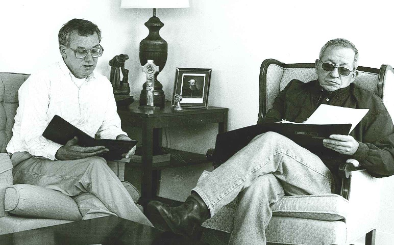 Fr. Sebastian (on right) reviewing some notes with Fr. Wayne Hellmann, OFM Conv.