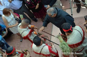 Fr. Miguel offers a blessing as two new council members of the Tigua Tribe receive the canes that are signs of their office and authority. (photo 2014, courtesy of Al Baeza)