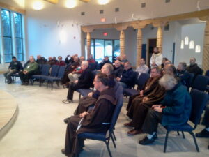 OFM Friars celebrate the Eucharist in the new Chapel.
