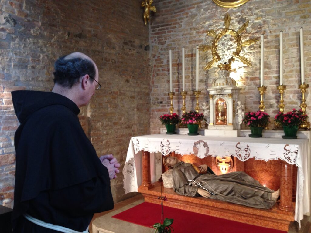 Fr. Jim prays before the place where St Anthony died.