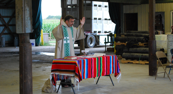 Fr. John celebrates Mass for  migrant farm workers in Ohio.