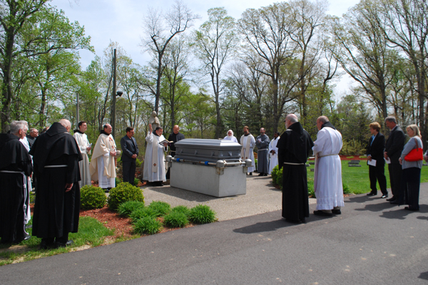 A final blessing at the cemetery at Mount St. Francis, Indiana