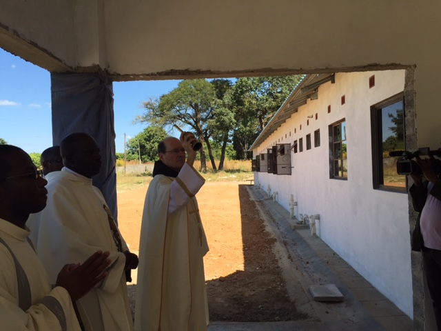 Fr. Jim blesses the new novitiate.