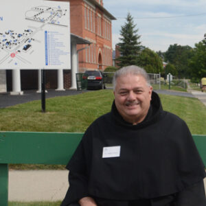 Br. Angelo waits to greet the pilgrims arriving by bus.