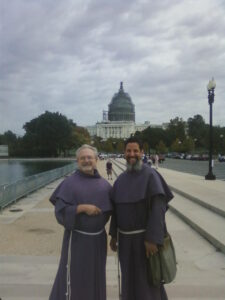 Friars Vincent Petersen and Don Bassana hit the ground in DC to greet Pope Francis