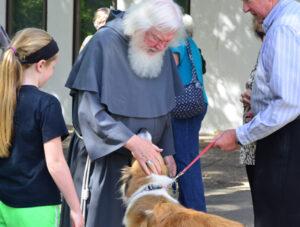 Fr. Maurice Hayes blesses the animals at Elizabeth Ann Seton Parish in Louisville, KY.