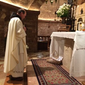 Fr. Jim Kent offering your petitions and placing them at the Tomb of St. Francis in Assisi.