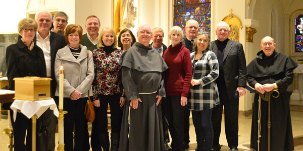 The family of +Fr. Terence Tobin with Fr. Raymond Mallett (center) and Fr. David Lenz (right)